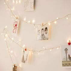 Hang pictures from twinkle lights!