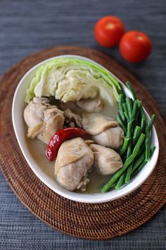 Sinampalukang manok is a sour soup dish made out of chicken, vegetables, tamarind and tamarind leaves, nearly similar to original sinigang except for the use of chicken and tamarind leaves.