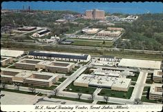 Great Lakes Naval Training Center. The mess Hall is the white bldg lower right, barracks on either side, long graduation drill hall with dark roof as it was when I was there in the 70`s.