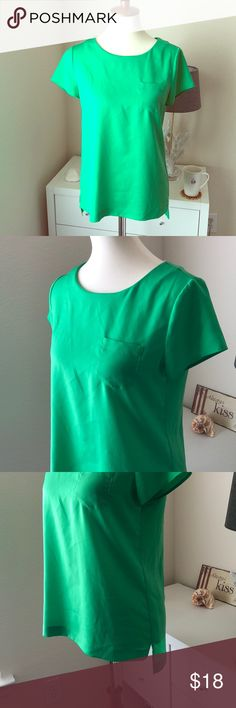 \J. Crew\• Kelly Green Silky Tee Beautiful green business casual tee with front pocket, side slits and slight high-low fall. Cute keyhole back. A very slight pull in the back, but not really noticeable. I will steam before shipping. 100% polyester. J. Crew Tops Blouses