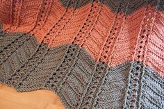 Columns of post stitch emphasize the shells in this ripple afghan. This is a quick and relatively simple pattern with a classy finished look.