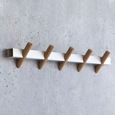 Designed by Faudet-Harrison for SCP, the Crosscut Coat Hooks are a simple and stylish means for hanging coats, hats, scarves, and other accessories. Made from a single piece of laser-cut rectangular steel and five cylindrical oak hooks, the wall-mounted rack can be used in an entryway, bedroom, or even a kitchen space as a quick way to eliminate clutter. The design sits flush on the wall for a seamless finish, and the upward facing hooks ensure that items will not easily slip off.  One unit…