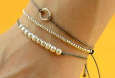 loving tiny, stacked bracelets right now. - Click image to find more DIY & Crafts Pinterest pins