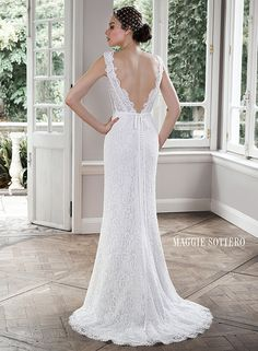 Subtle elegance is found in this classic lace sheath wedding dress with demure illusion lace and scalloped lace neck, Pierce by Maggie Sottero.