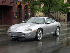 The XK series and XKR) is a grand tourer produced by the British automaker Jaguar since the 1997 model year. It is the replacement of the XJS,. Jaguar Xk8, Jaguar E Type, Jaguar Cars, Shooting Break, Automobile, Jaguar Daimler, Flower Car, Classic Cars Online, Station Wagon