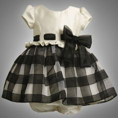 $46.95-$68.00 Baby Beautiful BLACK & WHITE SATIN & ORGANZA OVERLAY DRESS features SATIN BODICE with GENTLY PUFFED CAP SLEEVES, round neckline and PULL-THRU ORGANZA RIBBON & BOW TRIM at the RUFFLED WAISTLINE.  Fully lined WHITE SKIRT features BLACK/WHITE ORGANZA CHECK OVERLAY and attached slip with ruffled crinoline underskirt for added fullness plus back zip closure and ORGANZA BOW TIE SASH IN B ...