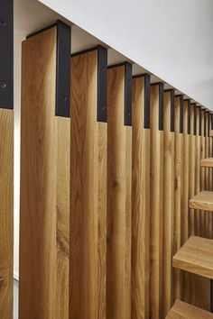 This is how we stand tall - Stair Panels. Type: Private Residence – Toronto Completed: 2016 Sumach Street was last modified: June 2016 by Beauparlant Design Wood Slat Wall, Wooden Stairs, Wood Slats, Stair Paneling, Stair Walls, Living Room Partition Design, Room Partition Designs, Wood Partition, Timber Battens