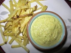 Green Peruvian Aji Sauce - really good! The only change I would make is to keep some of the jalapeño seeds. The sauce has good flavor and would benefit from a little spice. Also, the recipe mentions that the peanut butter is optional - definitely include it! It adds a much deeper flavor but doesn't make it taste peanut buttery. I had it with French fries, zucchini fries, home fries topped with an over easy egg.
