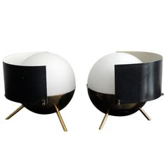 """Arredoluce lamps. Brass fittings with white frosted """"globes"""". Black and white enameled movable shade."""