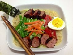 More homemade ramen. This one's got green beans, green onions, carrots, red peppers, half an egg and sausage. :)