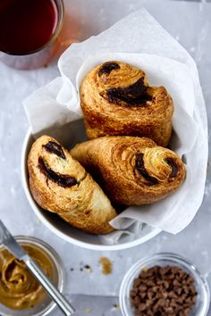 For quick and easy pain au chocolat, roll out some ready-made puff pastry, cut into long rectangles, sprinkle with chopped dark chocolate, roll up each rectangle, place on a baking tray and bake at 190C for 10-15 mins or until golden brown.
