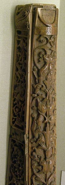 This is a beautiful Anglo-Saxon pen case carved from walrus ivory. The designs show variations of the tree of life. This shot shows to top of a long foliate design interlaced with lions and birds.  From the City of London.  Collection of the British Museum, London.