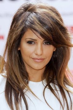 long layered hairstyle with side swept bangs