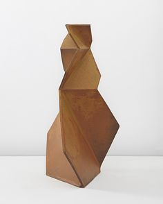 john mason. Asymmetrical. Repetition of shape but exaggeration makes for a more interesting composition.