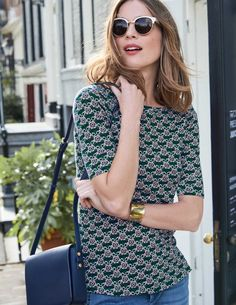 Brighten up your skirts and trousers with this easy-to-wear printed top. Crafted from lightweight jersey it's super comfortable to wear on its own or under a jacket on nippier days. The flattering boat neck and half-sleeve combination makes it a favourite wardrobe staple.