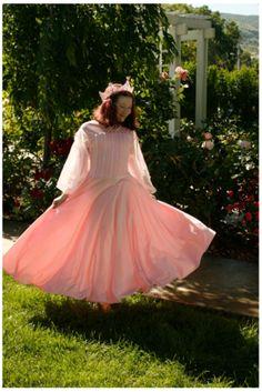 Youth spinning in pink Appleblossom dress