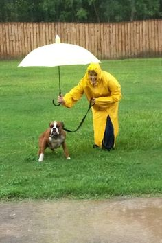 """Pinner said: """"What we do for our pets.... True Boxer love Me and Drake in the rain."""""""