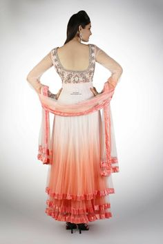 Ombre dyed Floor Length Anarkali in a neon pink and coral color with a deep scoop back and chudidar style sheer fitted cuff sleeves. The ent...