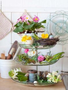Make a happy centerpiece by decorating each glass tier of the IKEA 365+ serving stand with spring flowers and dyed eggs.