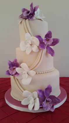 Ivory wedding cake with white and fuchsia butterfly orchids. Ivory Wedding Cake, Wedding Cakes, Custom Cakes, Yummy Cakes, Orchids, Butterfly, Baking, Birthday, Desserts