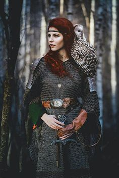 Celtic redhaired beauty and her bird.