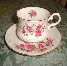 FANCY ROYAL MINSTER TEA CUP & SAUCER MOLDED PINK ROSES~via Pretty Vintage Things