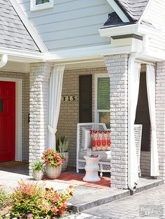 Place curtains outdoors for a practical embellishment to your front porch.