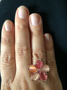Beautiful shining 18K plated luxury ring with orange and pink crystals. Ring is size USA 7 = 17.  Lovely for everyday wearing, occasional