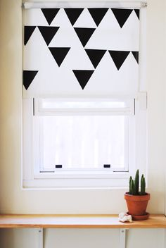 bedroom once repainted?  different geometric shapes?--restyled window with triangle vinyl shade