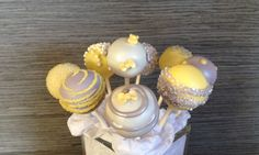 Yellow and gray cake pops by hautepopcouture