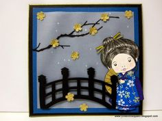 handmade card from Creations by Patti ... Japanese theme ... adorable LA La Land Kimono Marci with fan ... die cut bridge ... luv the die cut brance in black with tiny sakura blossoms punched from mat gold paper ... luv how the Copic coloring working on the hair ... vellum background paper over deep blue ... paper pieced kimono using origami paper ... wonderful card ...