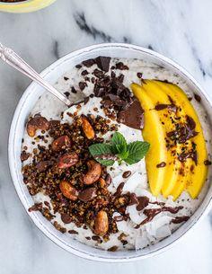 Coconut Banana Oats Smoothie Bowl with Crunchy Black Sesame Quinoa Cereal + Mango   halfbakedharvest.com