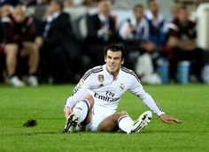 Gareth Bale of Real Madrid looks on after slipping as he strikes the ball at goal during the Dubai Football Challenge match between AC Milan and Real Madrid at The Sevens Stadium on December 30, 2014 in Dubai, United Arab Emirates.
