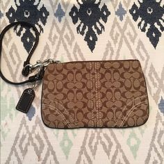 Authentic Coach Wristlet In perfect condition, no stains or tears. Classic Signature fabric. Strap is removable. Price is negotiable. Offers welcome! Coach Bags Clutches & Wristlets