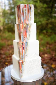 Designed by Sweet Fix, this contemporary wedding cake mixes the magic of dreamcatchers with the intrigue of abstract art. | Photo by Meredith Ryncarz #weddingcakes
