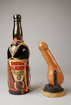Seized by the Rotterdam vice squad. Rum bottle with base removed to hide a dildo on a titling stand.