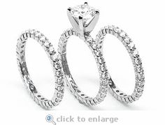 The Ziamond Cubic Zirconia 1 Carat 6.5mm Round Solitaire with Two Matching Eternity Bands in 14K White Gold. The Tribecca Stacking Set is a stunning bridal set featuring a 1 carat round set in a four prong head. Choose any carat size or shape of the center stone in addition to 14k white gold, 14k yellow gold, or platinum. $1895 #ziamond #cubiczirconia #cz #weddingset #bridalset #eternitystyle #solitaire #ring #14kgold #platinum #russianformula