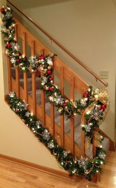 "I love how the double layer of garland on my stairs turned out this Christmas!  It makes an ugly staircase look pretty. :)  (Started with lighted garland, added beads, ribbon, ornaments, & snowflakes.  Lots of layers!)  The bottom layer simply rests on the ledge that's there.  I used a ""Command"" hook at the top to keep it from sliding back down the ledge."