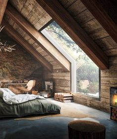 Attic Bedroom with wooden walls and huge window to enjoy nature outside at its fullest