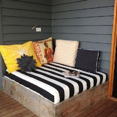would love outdoor nook under covered deck by a fireplace  DIY patio day bed - perfect for the corner on our porch