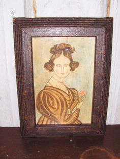 Folky portrait of an 1830 Lady with a flower in a painted and distressed frame by Steve Shelton.  Whitehorse Antiques, Rocheport, Mo  (SOLD).