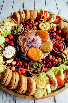 Epic Summer Burger Board Friends, building community isn't hard. Send that text, and make an invitation to host a summer gathering. Serve this Epic Summer Burger Board! Charcuterie Recipes, Charcuterie Platter, Charcuterie And Cheese Board, Tapas Platter, Cheese Boards, Party Food Platters, Party Trays, Food Trays, Party Buffet