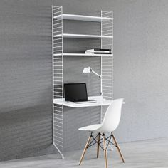 The String work desk is a beautiful and convenient addition to the String System collection – use it together with the 30 cm deep String panels. String System is a flexible shelving system that Swedish architect Nils Strinning designed in Office Shelf, Home Office, Desk Shelves, Bookshelves, White Shelves, String Regal, String Shelf, String System, Shelving Systems