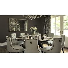 dining rooms - tufted baker dining chairs walnut round modern spider dining table taupe charcoal gray walls silver mirror French doors white black drapes found on Polyvore
