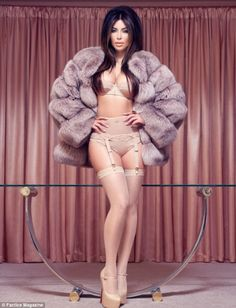 Kim Kardashian pin-up girl pose in a beige satin lingerie set with a fur coat…