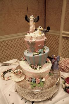 Disney's Cinderella wedding Cake-- oh wow the figures are chocolate!