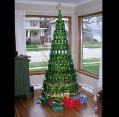 Fabulous idea for people who can't have a real tree. I would take it one step further and put xmas lights in or behind the bottle to really make them shine.