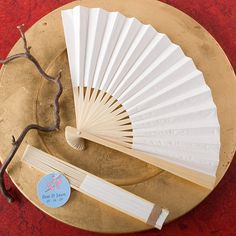 These elegant white folding wedding fans are fantastic favors and wedding essentials your guests are sure to open up to!Planning a summer event or destination wedding where temperatures may be soaring