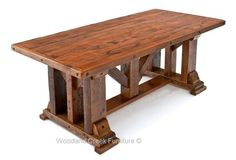 The base of the Barnwood Dining Table Timber Frame Design #1 uses classic post-and-beam construction to support the reclaimed wood tabletop. Reminiscent of barn rafters, the hefty timber frame has ample character and pays homage to the structures from where the wood was reclaimed. Two years ago Woodland Creek had a request for a custom made