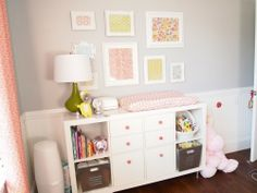 cute IKEA hack for a changing table.  Love the white frames, too.